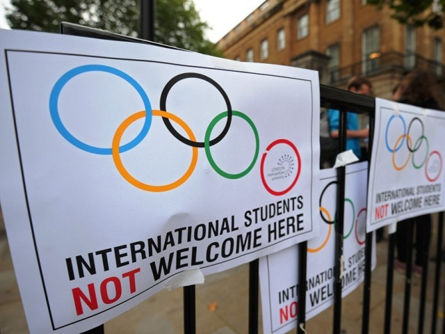Placards are pictured during a demonstration outside 10 Downing Street in London against the British governments decision to strip the London Metropolitan University of its right to sponsor visas for overseas students. PHOTO: AFP