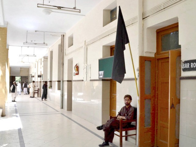 A black flag is seen outside the Bar Room in Quetta. PHOTO: PPI