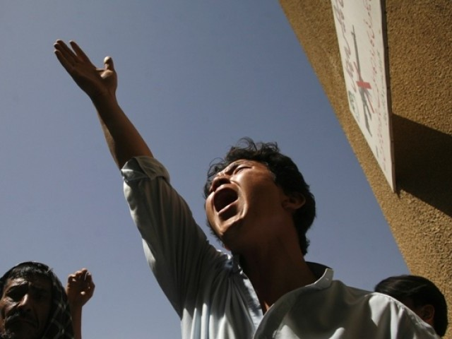 An ethnic Hazara shouts slogans while condemning the killings of relatives outside a hospital, where their bodies are located, in Quetta September 1, 2012. PHOTO: REUTERS