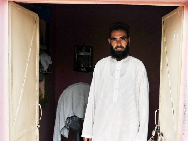 Hafiz Khalid Jadoon looks on from his room. PHOTO: AFP/FILE