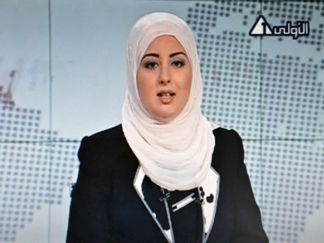 An image grab taken from Egyptian state TV shows Egyptian anchorwoman Fatma Nabil wearing an Islamic headscarf or hijab while reading the news on Channel 1 in Cairo on September 2, 2012. PHOTO: AFP