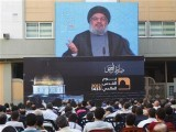 lebanons-hezbollah-leader-sayyed-hassan-nasrallah-addresses-his-supporters-via-a-screen-during-a-rally-marking-quds-jerusalem-dayin-the-southern-suburbs-of-beirut