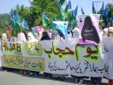 Activists of Jamaat-i-Islami women wing participate in World Hijab Day rally in Bahawalpur. PHOTO: ONLINE
