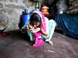 A woman sniffs heroin with the help of a paper tube at her home in the Ibrahim Hyderi Fish Harbour area on the outskirts of Karachi in this September 9, 2011 file photo. PHOTO: REUTERS
