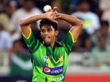 Pakistani spinner Raza Hasan bowls during their first Twenty20 match against Australia .PHOTO: AFP