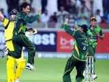 Pakistani spinner Mohammad Hafeez (L) celebrates after taking the wicket of Australian George Bailey. PHOTO: AFP