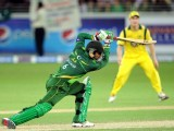 Pakistani batsman Shoaib Malik (L) plays a shot as Australian wicketkeeper Matthew Wade (R) looks on. PHOTO: AFP