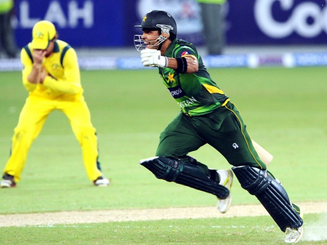 Pakistani batsman Umar Akmal celebrates after winning the second Twenty20 international cricket match against Australia. PHOTO: AFP