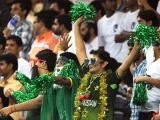 Pakistani cricket fans cheer for their team during the second Twenty20 international cricket match between Pakistan and Australia. PHOTO: AFP
