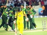 aeed Ajmal (R) celebrates with teammates after taking the wicket of Australian batsman David Warner. PHOTO: AFP