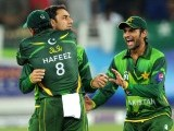 Pakistani captain Mohammad Hafeez (L) celebrates with spinner Saeed Ajmal (C) and Shoaib Malik (R) after the dismissal of Shane Watson. PHOTO: AFP