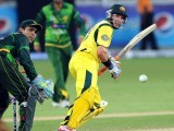 Michael Hussey (R) plays a shot next to Pakistani wicketkeeper Kamran Akmal. PHOTO: AFP
