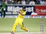 Michael Hussey plays a shot during their second Twenty20 international cricket match against Pakistan in Dubai September 7, 2012. PHOTO: REUTERS