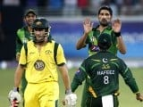 Sohail Tanvir (R) celebrates the wicket of Australia's David Hussey (2nd L) during the second Twenty20 international cricket match in Dubai September 7, 2012. PHOTO: REUTERS