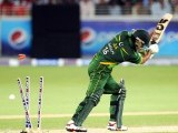Imran Nazir is bowled out by Mitchell Starc during the second Twenty20 international cricket match. PHOTO: AFP