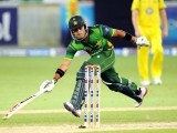 Umar Akmal completes a run during the second Twenty20 international cricket match. PHOTO: AFP