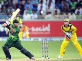 Nasir Jamshed (L) plays a shot next to Australian wicketkeeper Matthew Wade during the second Twenty20 international cricket match. PHOTO: AFP