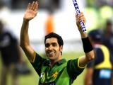 Umar Gul waves to spectators after their victory in the second Twenty20 international cricket match against Australia in Dubai September 7, 2012. PHOTO: REUTERS