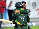 Abdul Razzaq and Kamran Akmal (back) celebrate after winning the second Twenty20 international cricket match against Australia. PHOTO: AFP