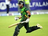 Umar Akmal celebrates after scoring the winning runs in the second Twenty20 international cricket match against Australia. PHOTO: AFP