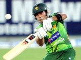 Umar Akmal plays a shot during the second Twenty20 international cricket match against Australia. PHOTO: AFP