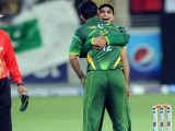 Captain Mohammad Hafeez celebrates with teammate Abdul Razzaq after the dismissal of Australian captain George Bailey. PHOTO: AFP