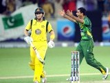 Abdul Razzaq (R) celebrates after taking the wicket of Australian captain George Bailey (L). PHOTO: AFP