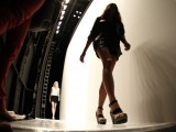 A model walks offstage during a run though to the backstage before the Spring-Summer Rebecca Minkoff show during New York Fashion Week. PHOTO: REUTERS