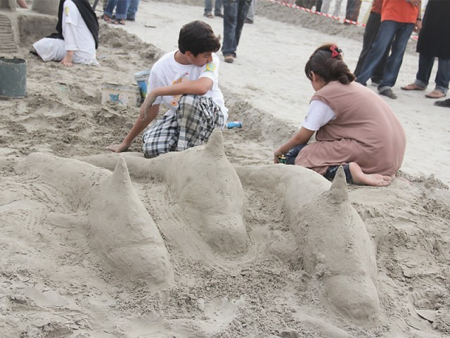 Siblings Hamza and Aneeqa building their dolphins which won the third prize. It took them an hour to complete the work. PHOTO: AYESHA MIR/EXPRESS