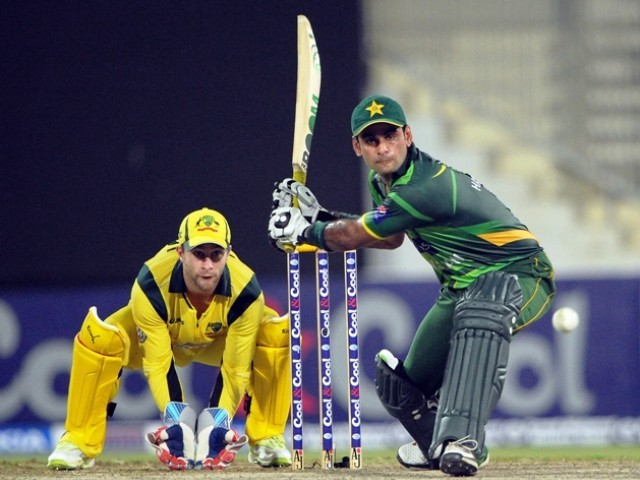 Mohammad Hafeez (R) plays a shot in front of Australian wicketkeeper Matthew Wade. PHOTO: AFP