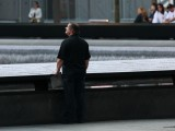 A man stands at the National September 11 Memorial before ceremonies marking the 11th anniversary of the September 11 attacks on the World Trade Center. PHOTO: REUTERS