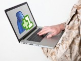 soldier-laptop-computer-600-add-friend-facebook