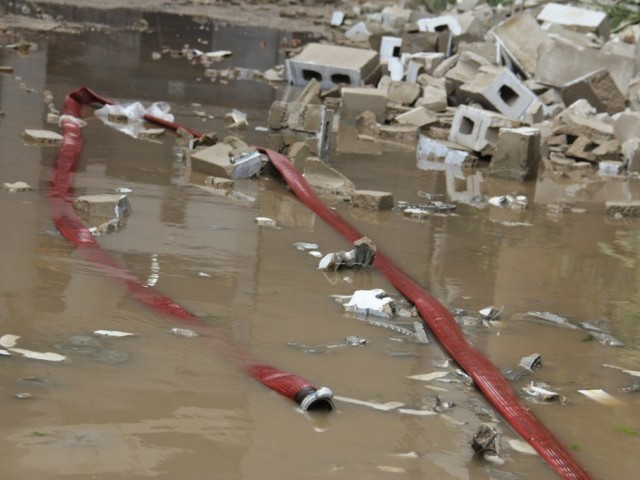 Rescue work continues at the factory. PHOTO: AYESHA MIR/ THE EXPRESS TRIBUNE