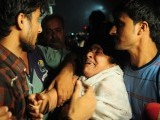 A woman mourns the death of her relatives in front of the garment factory in Karachi on September 12, 2012. PHOTO: AFP