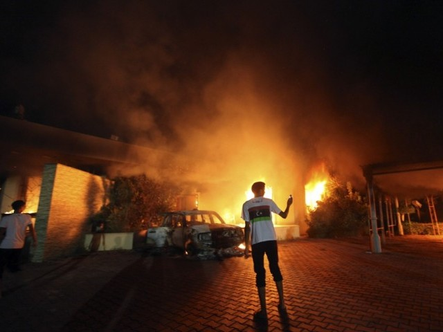 The US Consulate in Benghazi is seen in flames during a protest by an armed group said to have been protesting a film being produced in the United States September 11, 2012.  PHOTO: REUTERS