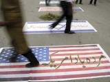 Muslim demonstrators walk over US and Israeli flags as they attempt to reach the US embassy during a demonstration against an anti-Islam film in Islamabad on September 14, 2012. PHOTO: AFP