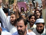 Pakistani Muslim shout anti-US slogans during a rally against an anti-Islam movie in Peshawar on September 16, 2012.  PHOTO : AFP