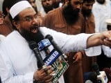 Hafiz Mohammad Saeed, head of Pakistan's outlawed group Jamaat ud Dawa (JD), addresses supporters during a rally against an anti-Islam movie in Lahore on September 16, 2012. PHOTO : AFP
