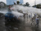 Pakistani policemen use a water cannon to disperse the Shiite Muslim protesters during a rally against an anti-Islam movie in Karachi on September 16, 2012. At least three people were injured after protesters at a rally held in the port city of Karachi to denounce an anti-Islam movie clashed with the police. A total of 17 people have died in violence linked to the film, including four Americans killed in Benghazi, 11 protesters who died as police battled to defend US missions from mobs in Egypt, Lebanon, Sudan, Tunisia and Yemen, and the two US soldiers in Afghanistan. PHOTO : AFP