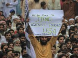 A supporter of the Jamaat-ud-Dawa Islamic organisation holds up a placard while taking part with others in an anti-American rally in Lahore on September 16, 2012. PHOTO : REUTERS