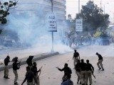 Pakistani police fire tear gas shells towards Shiite Muslim protesters during a rally against an anti-Islam movie in Karachi on September 16, 2012. PHOTO ; AFP