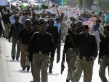 A large contingent of police personnel were deployed to avoid the protestors from reaching the US consulate. PHOTO: EXPRESS/MOHAMMAD IQBAL