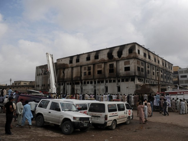 One of the suspects had repeatedly called the factory owners the day of the fire. PHOTO: AFP/FILE