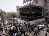 A multistoried outlet of American fast food chain KFC was burnt by protesters in Karachi in May 2005. PHOTO: REUTERS/FILE