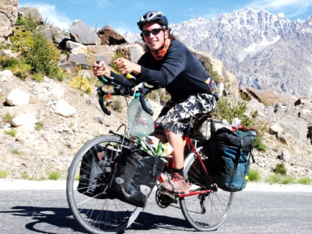 Denise Davies cycles in Chitral. PHOTO: THE EXPRESS TRIBUNE