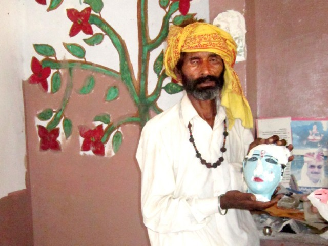 Maharaj Sunda, caretaker of Shri Krishna Bhagwan Mandir, shows a vandalised idol. PHOTO: EXPRESS