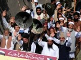 Hafiz Mohammad Saeed (2R), Sami ul Haq (2L), and Munawar Hasan (L) lead an anti-US rally against US-made anti-Islam film and the publication of  blasphemous cartoons in France, in Peshawar on October 1, 2012. PHOTO: AFP