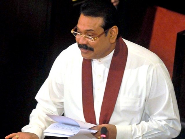 Sri Lankan President Rajapakse says he would be happy if international cricket returns to Pakistan. PHOTO: AFP