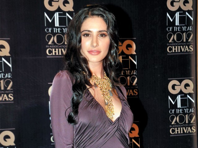 Nargis Fakhri of Rockstar looked seductive in a Roberto Cavalli aubergine gown at the GQ Men of the Year Awards 2012.