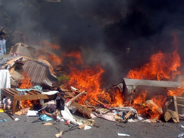 File photo of people burning items from a Christian family's house. PHOTO: EXPRESS/ FILE